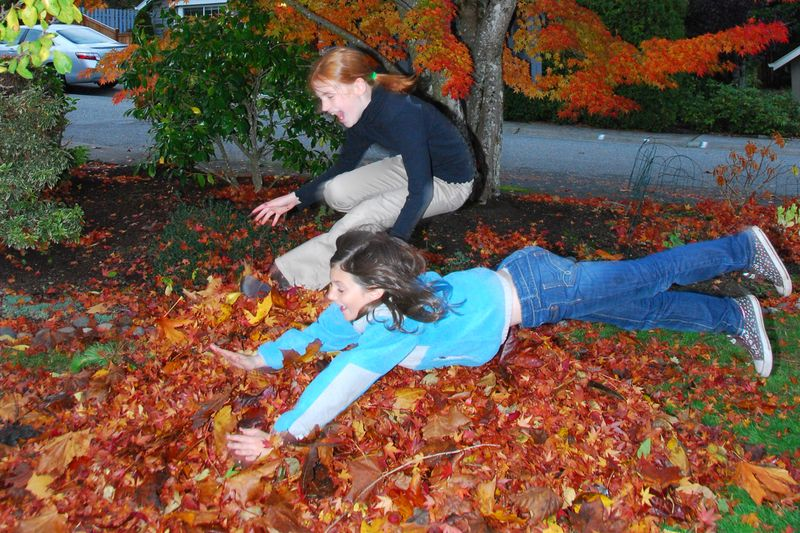 A and M jumping in the leaves 10 30 09
