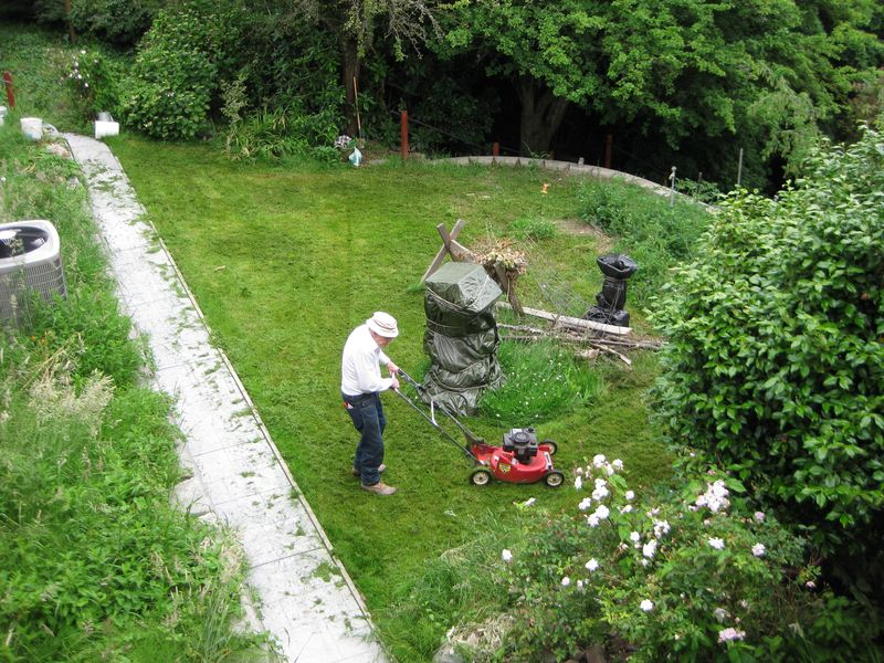 94 year old Tom mows lawn